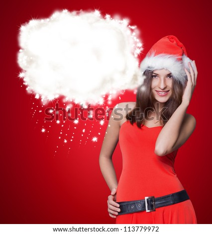 Young happy girl in Christmas hat. Blank graphic design balloon overhead - stock photo