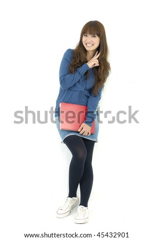 Young happy girl student smiling and holding notebooks