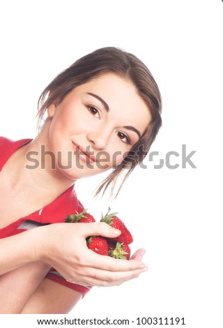 Young happy girl  with fresh  strawberries
