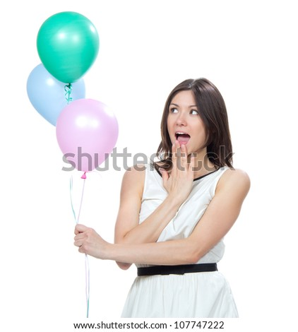 Young happy girl with pink balloons as a present for birthday party smiling and looking at the corner on a white background