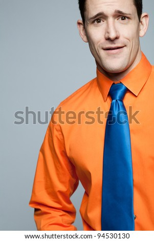Young happy handsome man in orange shirt.