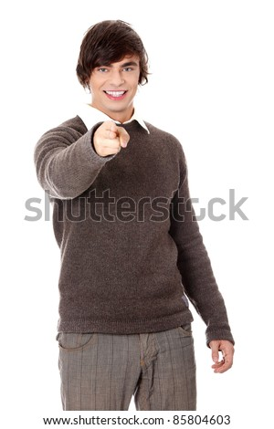 Young happy handsome man pointing on you, isolated on white