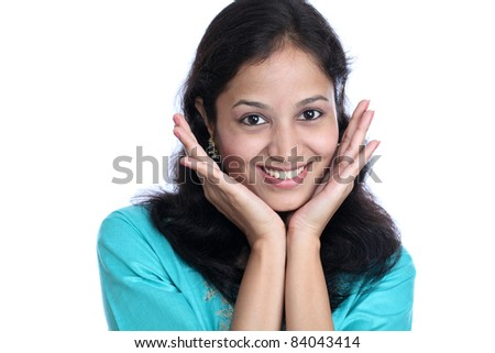 Young happy indian woman with hands on chin