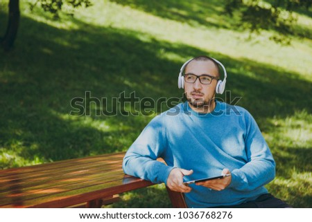 Young Happy Man Or Student With Laptop And Phone On The