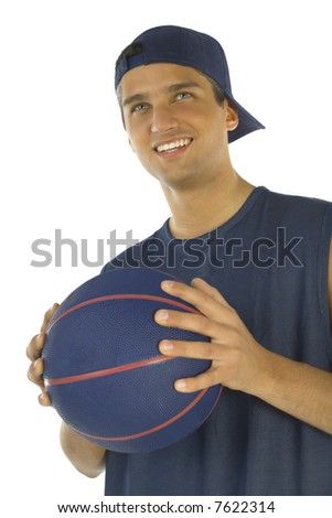 Young, happy man holding basketball in hands. White background, front view.