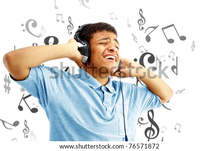 Young happy man listening to music and singing