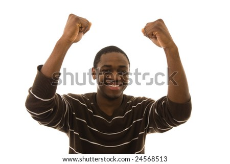 Young happy man with arms up celebrating something