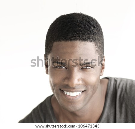 Young happy man with big natural smile against white background