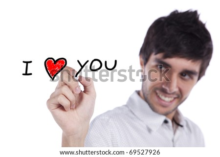 Young happy man writing a love message on the whiteboard (selective focus)