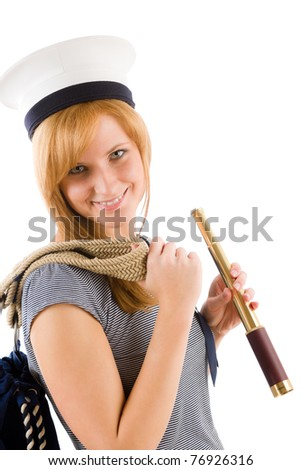 Young happy marine woman with spyglass in sailor hat