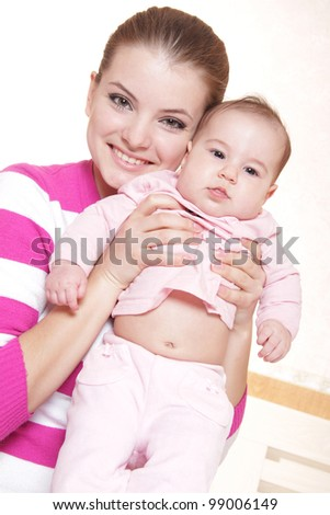 young happy mother and baby at home - stock photo