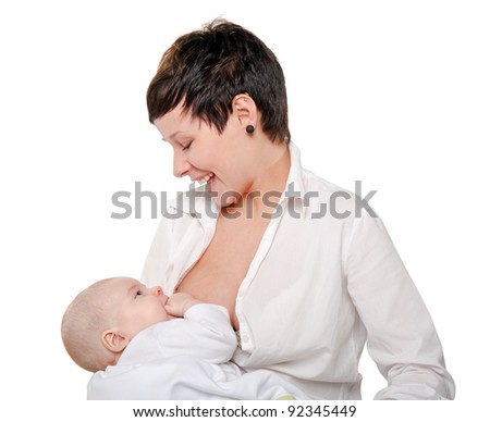 young happy mother suckles a child on a white background.breastfeeding