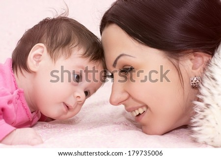 Young happy mother with baby