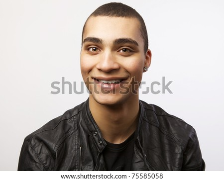 Young happy mulatto in a leather jacket. Portrait with smile.