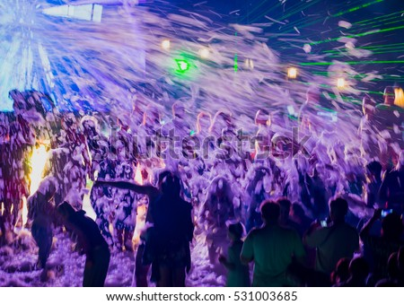 Young happy people are dancing in club. Nightlife and disco concept. #531003685