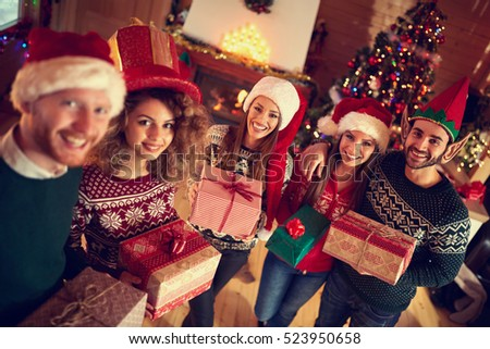 Young happy people on Christmas with gifts