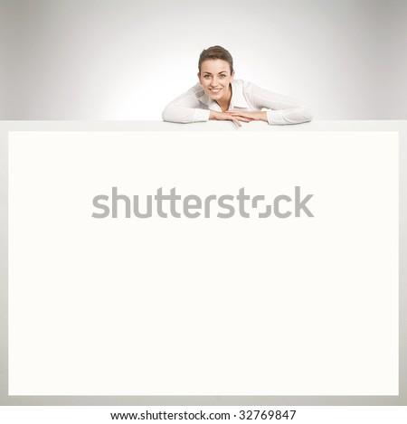 Young happy secretary over white board