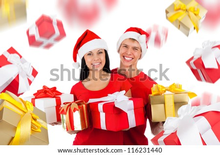 Young happy smile excited couple wear red Christmas hats and shirts, hold gold gift box present, looking at camera, present golden gift box fall fly around isolated over white background