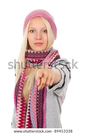 young happy smile teenage girl point finger at you gesture, looking at camera, wear winter knitted pink hat scarf and sweater, isolated over white background