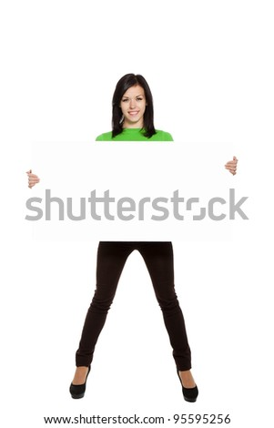 young happy smile woman standing hold blank board, attractive girl wear green shirt, full length, isolated over white background, studio shoot - stock photo