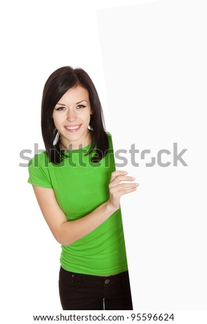 young happy smile woman standing hold blank board, attractive girl wear green shirt, isolated over white background, top angle view, studio shoot