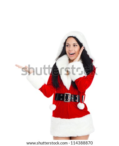 young happy smile woman wear Santa Clause costume hold open palm pointing to side empty copy space attractive christmas new year party girl, isolated over white background