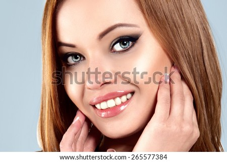 Young Happy Smiling Beautiful Natural Woman Touching Face with her Hands. Perfect Clear Skin. Beauty Smile, Healthy White Teeth. #265577384