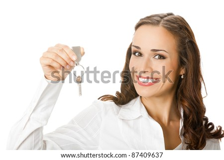 Young happy smiling business woman or real estate agent showing keys from new house, isolated over white background