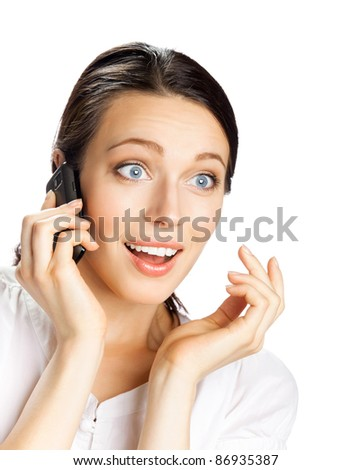 Young happy smiling business woman with cell phone, isolated over white background