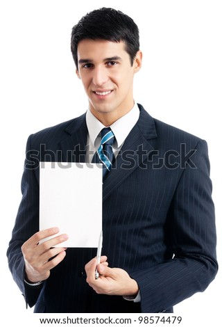 Young happy smiling businessman showing signboard with copyspase for text or slogan, isolated over white background