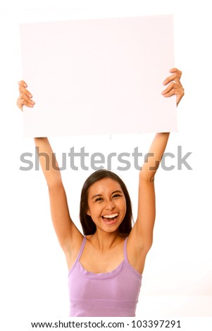 Young Happy Smiling Caucasian / Asian Woman Holding Up a Blank White Placard / Board. Isolated on White Background. With Copy Space for Text / Logo
