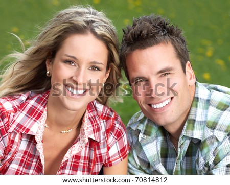 Young  happy smiling couple in love - stock photo