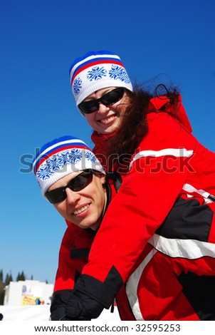Young happy smiling couple. Ski resort.