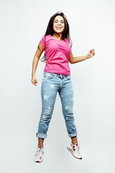 young happy smiling latin american teenage girl emotional posing on white background, jumping flying in joy, lifestyle people concept