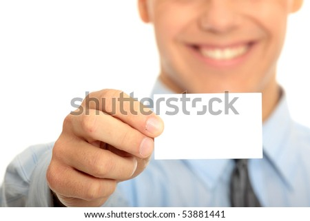 Young happy smiling successful business man with blank business card or sign