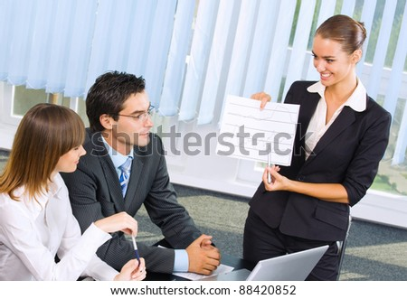 Young happy smiling successful businesspeople at meeting, presentation or conference