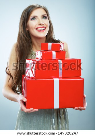 Young happy smiling woman hold red gift box. Isolated studio background female model.