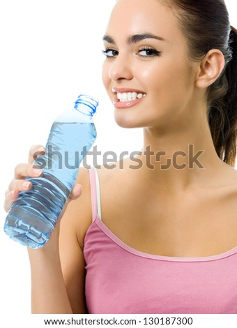 Young happy smiling woman in sportswear drinking water, isolated over white background