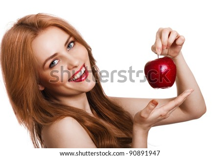 Young happy smiling woman with apple isolated on white