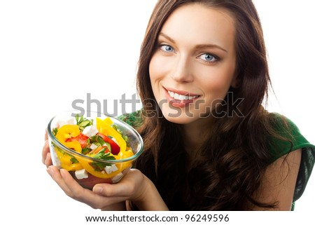 Young happy smiling woman with fegetarian salad, isolated over white background