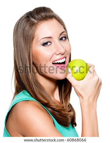 Young happy smiling woman with green apple - isolated on white