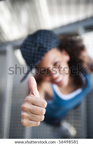 Young happy sportive woman in urban background - stock photo