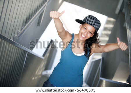 Young happy sportive woman in urban background