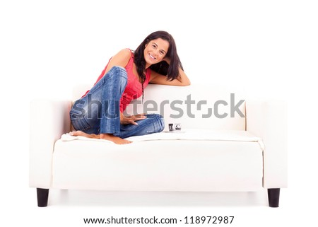 Young happy woman at house, taking a moment to relax