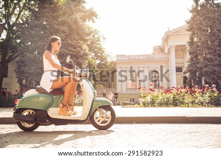young happy woman driving...