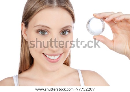 Young happy woman holding crystal ball isolated on white background. - stock photo