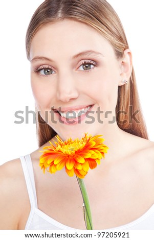 Young happy woman holding gerbera flower isolated on white background.
