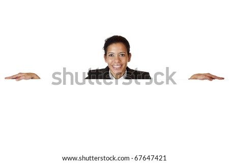 Young happy woman leans on blank billboard. Isolated on white background.