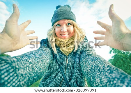 Young happy woman meeting her boyfriend outdoors - Personal point of view of man hands embracing smiling woman - Love concept with girlfriend dating her guy - Vintage bright desaturated filtered look
