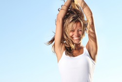 young happy woman on sky background